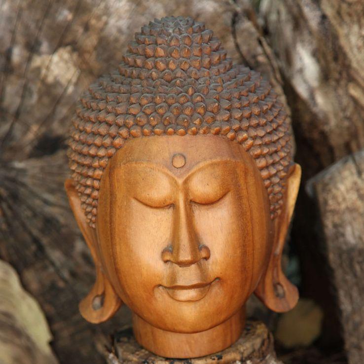 Carved wood Buddha head